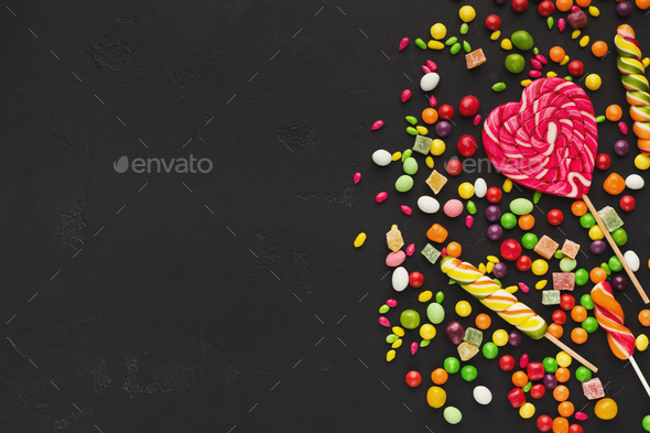 Colorful food background with candies and bonbons - Stock Photo - Images