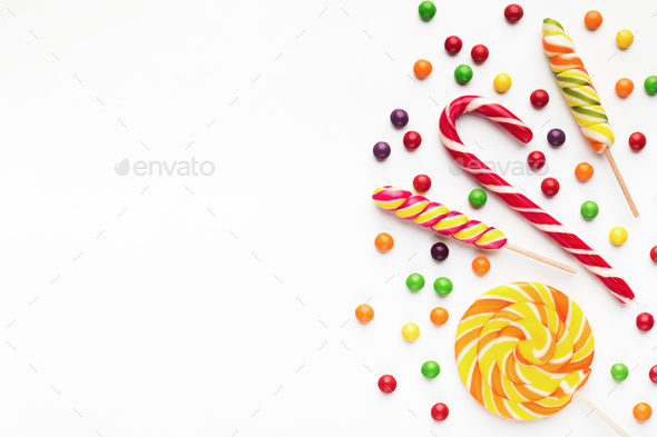 Colorful holiday background with candies and bonbons - Stock Photo - Images