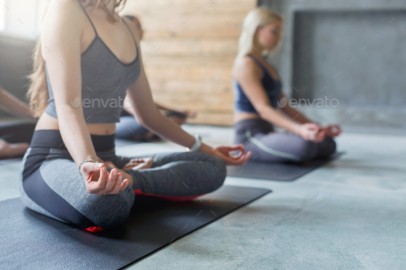 Young women in yoga class, relax meditation pose - Stock Photo - Images