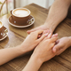 Young couple in love holding hands in cafe - PhotoDune Item for Sale