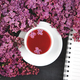 Cup of tea and branches of flowers bouquet blooming lilac - PhotoDune Item for Sale