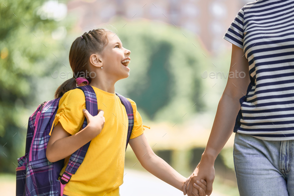 Parent and pupil go to school - Stock Photo - Images