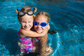 two little girls playing in the pool - PhotoDune Item for Sale