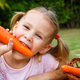 happy little girl holding a carrots - PhotoDune Item for Sale
