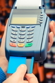 Using payment terminal and credit card in shop, cashless paying for shopping or products concept - PhotoDune Item for Sale