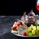 delicacy blue cheeses, fruit and jam in jar with red wine in glass on black slate - PhotoDune Item for Sale