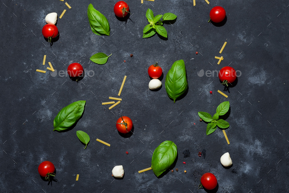 Mozzarella cheese, basil and tomato cherry on slate stone board, copy space and top view. - Stock Photo - Images