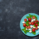 Fresh italian caprese salad with mozzarella and tomatoes on blue plate - PhotoDune Item for Sale