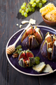 Gourmet appetizer of figs with goat cheese,walnuts and honey on ceramic plate - PhotoDune Item for Sale