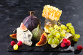 delicious cheese with fresh honey, figs slice and grapes on dark slate board - PhotoDune Item for Sale