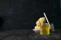 Honey jar with a wooden stick drains honey on an dark background , pure natural sweet goodness - PhotoDune Item for Sale