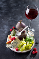 delicacy blue cheeses, fruit and jam in jar with red wine in glass - PhotoDune Item for Sale