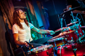 Drummer playing on drum set on stage. - PhotoDune Item for Sale