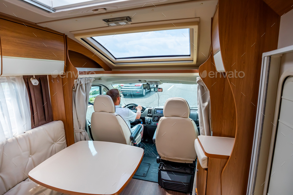 Man driving on a road in the Camper Van RV - Stock Photo - Images