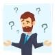 Thinking Businessman Standing Under Question Marks