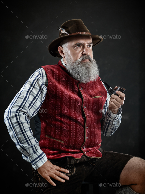 dramatic portrait of senior smoking tobacco pipe - Stock Photo - Images