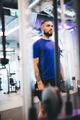 Young man standing with dumbbells at the gym - PhotoDune Item for Sale