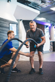 Senior man exercising with ropes at the gym. - PhotoDune Item for Sale