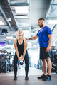 Woman working out with personal trainer at a gym. - PhotoDune Item for Sale