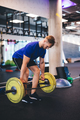 Muscular man lifting weights at the gym. - PhotoDune Item for Sale