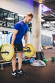 Man working out at the gym, lifting weights. - PhotoDune Item for Sale
