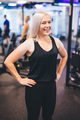 Smiling woman standing in a gym - PhotoDune Item for Sale