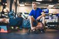 Young man helping senior man in a workout. - PhotoDune Item for Sale