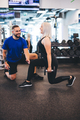 Woman exercising with personal trainer - PhotoDune Item for Sale