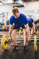Fit man lifting weights at the gym. - PhotoDune Item for Sale