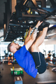 Man pulling his body up on the rig at the gym. - PhotoDune Item for Sale