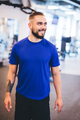 Smiling man standing in a gym. - PhotoDune Item for Sale