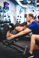Young man assisting senior man at the gym. - PhotoDune Item for Sale
