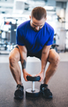 Young man lifting dumbbell at the gym. - PhotoDune Item for Sale