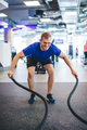 Young man exercising with ropes at the gym. - PhotoDune Item for Sale