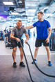 Senior man exercising at the gym with gym instructor. - PhotoDune Item for Sale