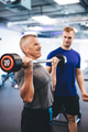 Senior man weightlifting, assisted by personal trainer. - PhotoDune Item for Sale