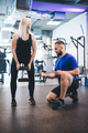 Woman exercising with personal trainer. - PhotoDune Item for Sale