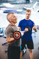 Senior man and personal trainer at the gym. - PhotoDune Item for Sale