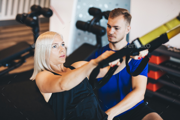 Young woman exercising with personal trainer. - Stock Photo - Images