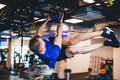 Man exercising on a rig at the gym. - PhotoDune Item for Sale
