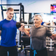 Older man assisting senior man at the gym. - PhotoDune Item for Sale