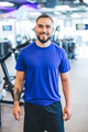 Happy man standing in a gym. - PhotoDune Item for Sale