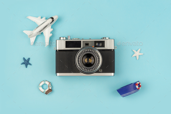 Retro Camera With Toy Plane On Pastel Blue Background Stock Photo Images