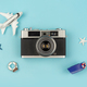 Retro camera with toy plane on pastel blue background - PhotoDune Item for Sale