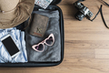 Traveler baggage with clothes and accessories, Travel vacation trip concept - PhotoDune Item for Sale