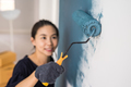 Young asian happy woman painting interior wal - PhotoDune Item for Sale
