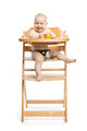 Cute baby girl eating peach and smiling  - PhotoDune Item for Sale