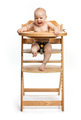 Happy cute baby girl sitting in high chair over white - PhotoDune Item for Sale