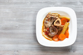 italian dish Ossobuco in white plate on gray board - PhotoDune Item for Sale