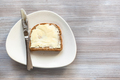 sandwich with butter and knife on white plate - PhotoDune Item for Sale